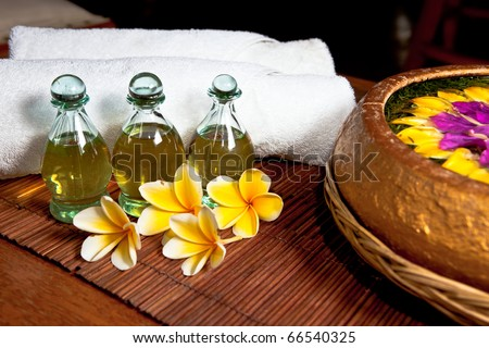 bottles of essential oil in a spa composition - stock photo