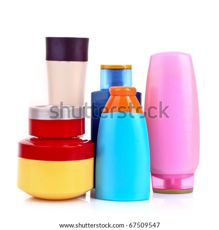 bottles of health and beauty products isolated on white - stock photo