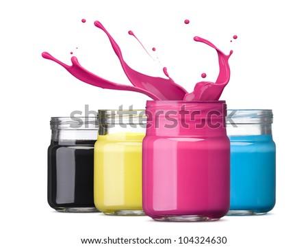 bottles of ink in cmyk colors, magenta with splash - stock photo