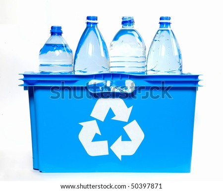 bottles of mineral water  inside recycle bin against white background - stock photo