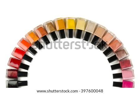 Bottles of nail polish semicircle. Isolate on white. - stock photo