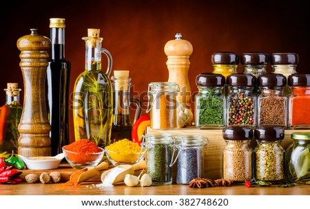 Bottles of oil and Balsamic vinegar and different spices and seeds and cooking ingredients - stock photo