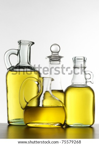 bottles of oil on a white background
