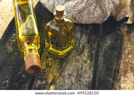 bottles of olive oil and sliced rustic bread