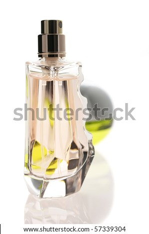 Bottles of pink and green perfume isolated on white background with reflection.
