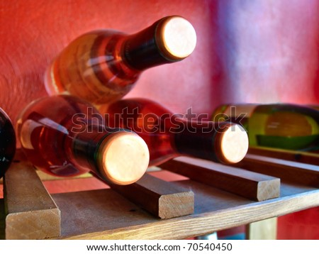 bottles of rosy wine in a wine shop - stock photo