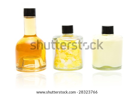 Bottles of spa oil and salt on white background