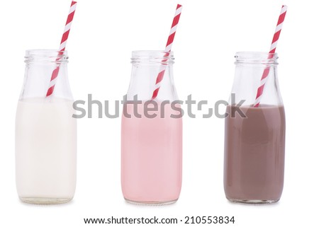 Bottles of vanilla, chocolate, and strawberry milk  - stock photo
