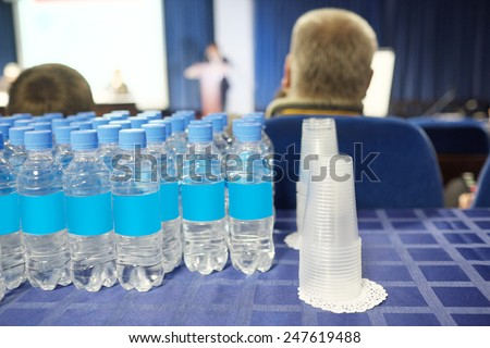 bottles of water and glasses in the conference hall - stock photo