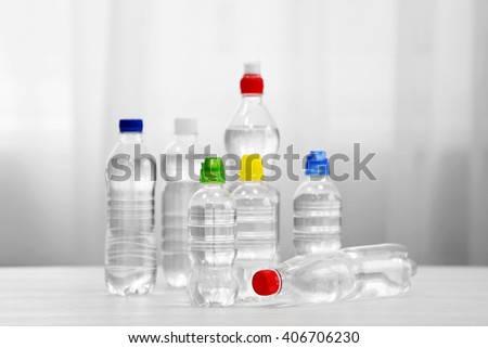 Bottles of water on the white table. - stock photo