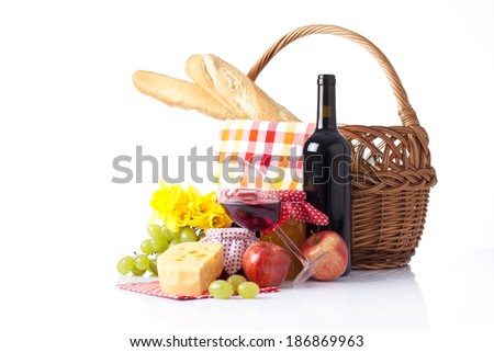 Bottles of wine and Picnic basket with glasses