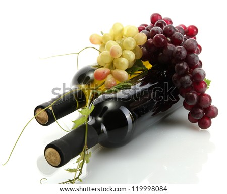 bottles of wine and ripe grapes isolated on white - stock photo