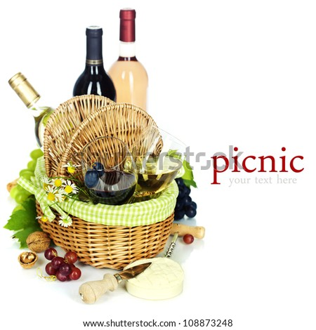 Bottles of wine, grape and Picnic basket with glasses  (easy removable sample text) - stock photo