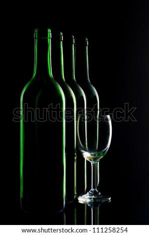 Bottles of wine on black background. - stock photo