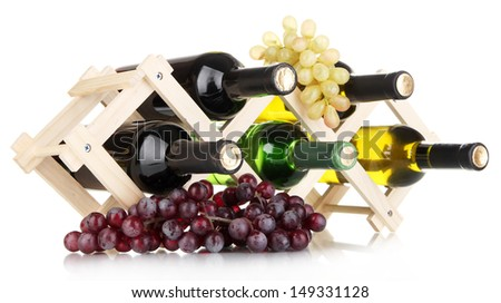 Bottles of wine placed on wooden stand isolated on white - stock photo