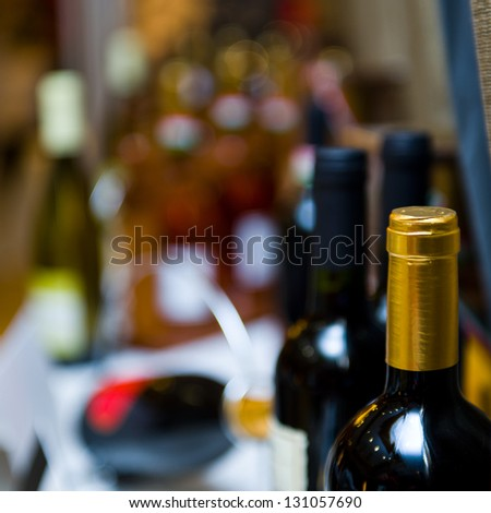 Bottles of wine shot with limited depth of field. - stock photo