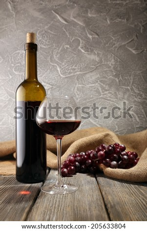 Bottles of wine with glass - stock photo