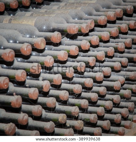 Bottles sealed with wine in storage - stock photo