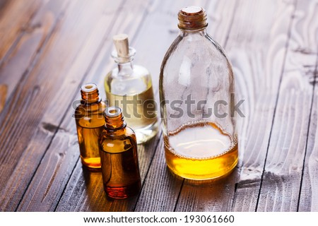 Bottles with aroma oil, medicines  on wooden background. Selective focus,horizontal. - stock photo