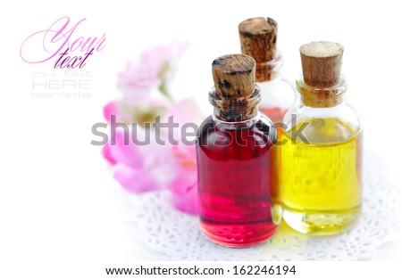 Bottles with basics oils on a white background - stock photo