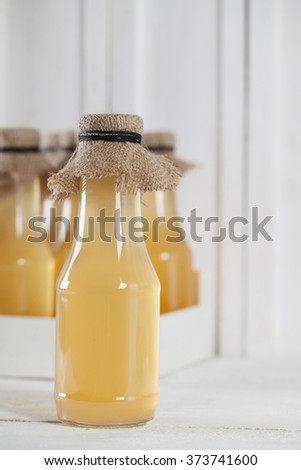 Bottles with homemade syrup. Can be used as a photo of various kinds of syrup or lemonade. - stock photo