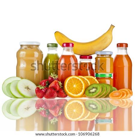 Bottles with juice fruits  isolated on white - stock photo