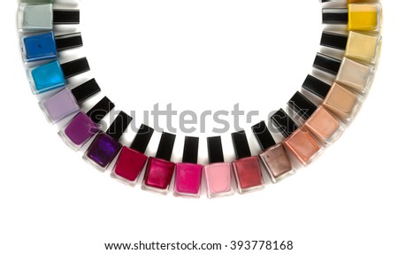 Bottles with nail polish arranged in a semicircle. Isolate on white background. - stock photo