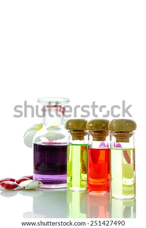 Bottles with natural aroma oil, essentials and fragrances aligned on white  - stock photo