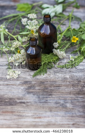 Bottles with organic oil  on  wooden background. Selective focus. Place for text.