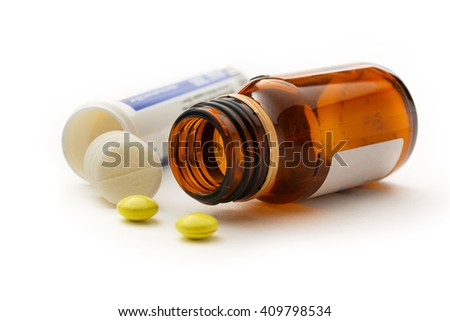 Bottles with pills in closeup on white - stock photo