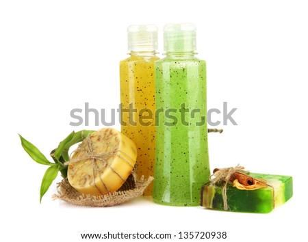 Bottles with scrub and hand-made soap, isolated on white - stock photo