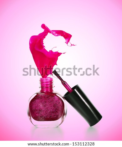 Bottles with spilled nail polish - stock photo