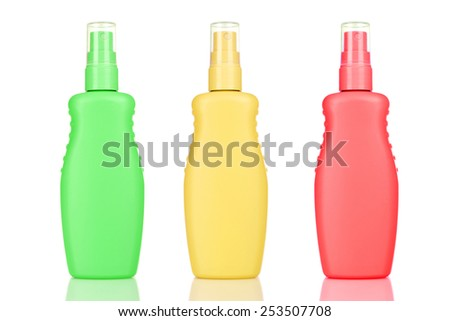 Bottles with suntan cream isolated on white - stock photo