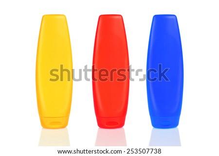 Bottles with suntan cream isolated on white - stock photo