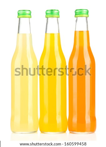 Bottles with tasty drink, isolated on white