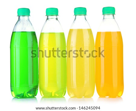 Bottles with tasty drinks, isolated on white