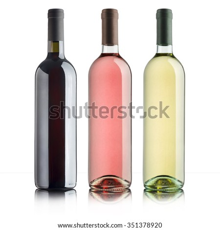 bottles with variety of wines, on white background
