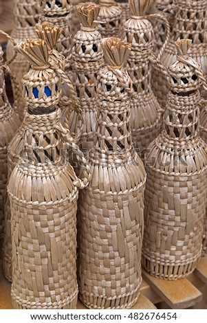 Bottles wrapped decorative with wicker.