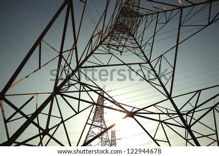 Bottom mesh transmission power towers - stock photo