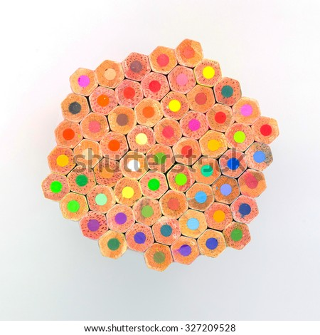 Bottom of multiple colours wooden pencil on white background - stock photo