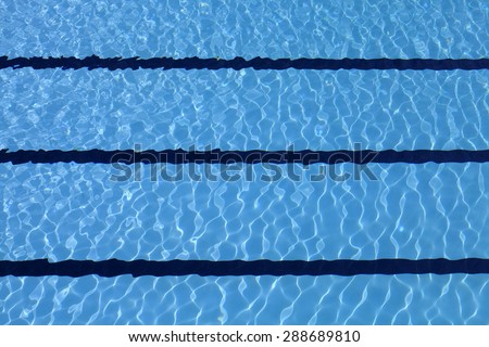 Bottom of the pool through the transparent waters - stock photo