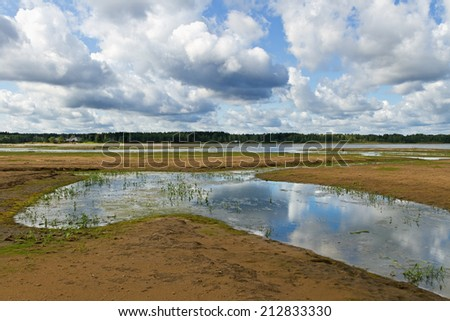 Bottom of the river after the water drain for hydroelectric station repair. - stock photo