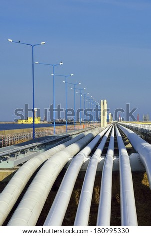 Bottom shot of a pipeline at sunset. Pipeline transportation is most common way of transporting goods such as Oil, natural gas or water on long distances. - stock photo