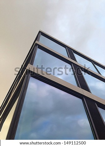 Bottom-up illustrated view of a business building, referring to concepts such as business, management, economics, administration, employment and finances - stock photo