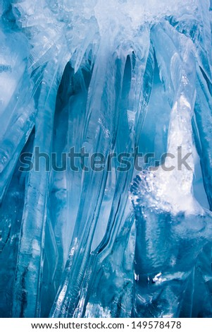 Bottom-up view of blue icicles. Freezing atmosphere - stock photo