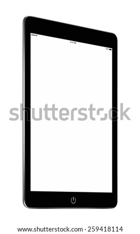Bottom up view of rotated at a slight angle black tablet computer with blank screen mockup isolated on white background. High quality. - stock photo