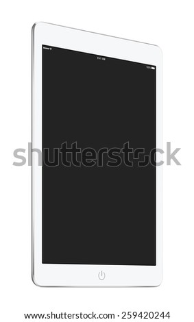 Bottom up view of rotated at a slight angle white tablet computer with blank screen mockup isolated on white background. High quality. - stock photo