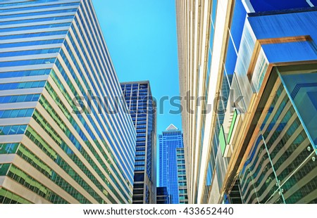 Bottom up view of skyscrapers reflected in glass in Philadelphia, Pennsylvania, USA. It is central business district in Philadelphia - stock photo