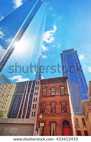 Bottom-up view on skyscrapers mirrored in glass in Philadelphia, Pennsylvania, USA. It is central business district in Philadelphia - stock photo