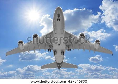 Bottom view airplane takeoff to the sky - stock photo